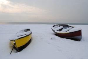 2.Boats on the snowy beach by Ivana Vavreckova