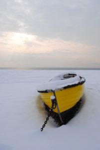 Boat on the snowy beach by Ivana Vavreckova