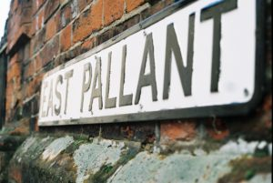 East Pallant Street Sign by Corona