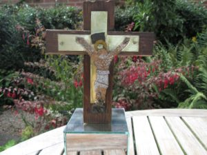 Crucifix metal and wood on mirrored base by stella