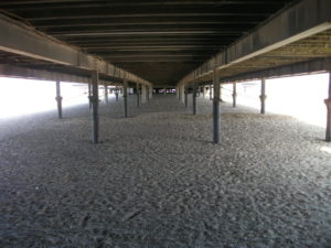 Under the Pier by Brett Hidden