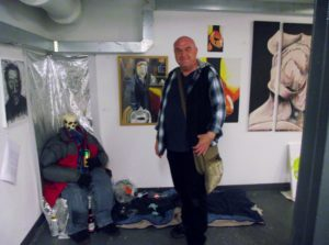 Artist with his work by Paul Ashton