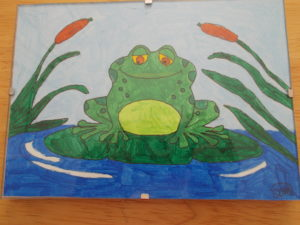 Frog peacefully sitting on a lily pad by sophie mayes