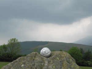 grief ball sculpture at castlerigg stone circle by LANDSCAPE OF GRIEF