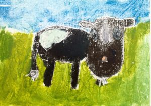 Cow eating grass by Kirsty