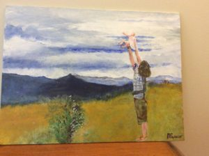 Dan holding his baby to the world by Michael Spencer