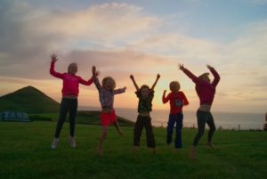 Happy jumping children by Amy Barlow