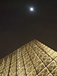 Moon Over the Louvre by Portrait in Newspaper