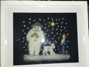 The snowman snowdog and snowboy by VJ Francis
