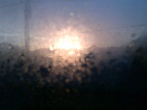Sunrise Through A Steamed Up Window by G.E.W. Shepherd