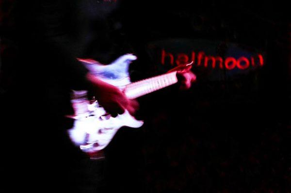 halfmoon guitarist by Nuala H