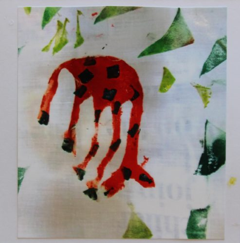 Giraffe with its head down by Ruth Harrisson