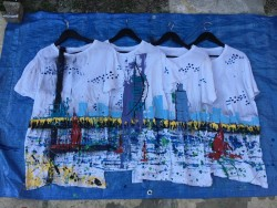 Painting on blue fabric with white t-shirts