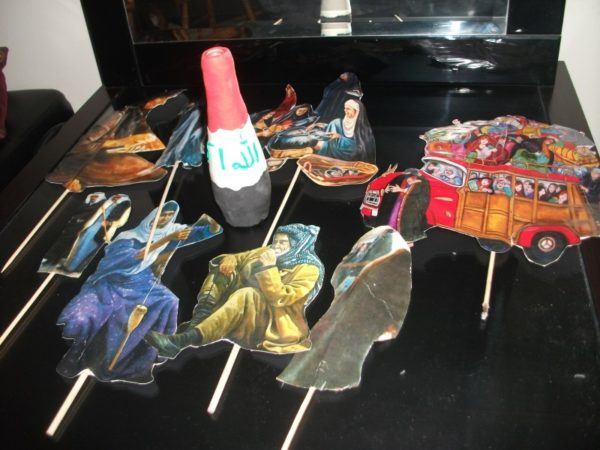 Eight stick  puppets by Iraqiwomenartwar المراة العراقية ،الفن و الحرب