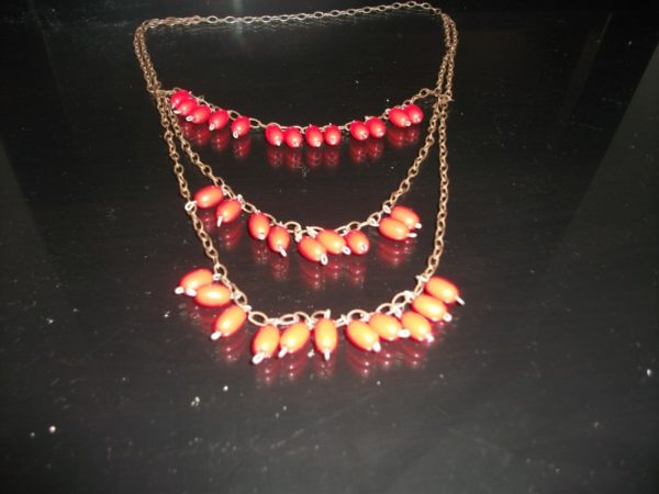 Red beads necklace by Colourful circle table