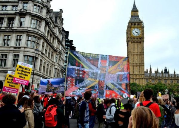 The New Union Flag at pro refugees demo outside the House of Parliament (2017) by No Man's Land Project