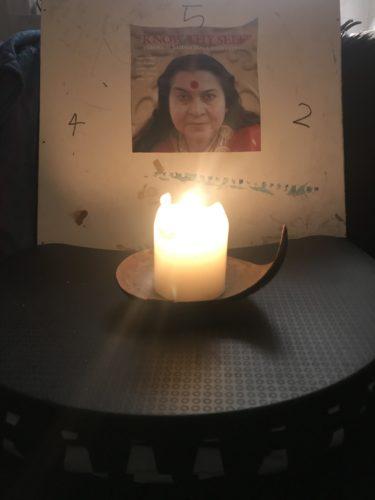 Meditation with shri mateji image and candle by Samantha Sugars
