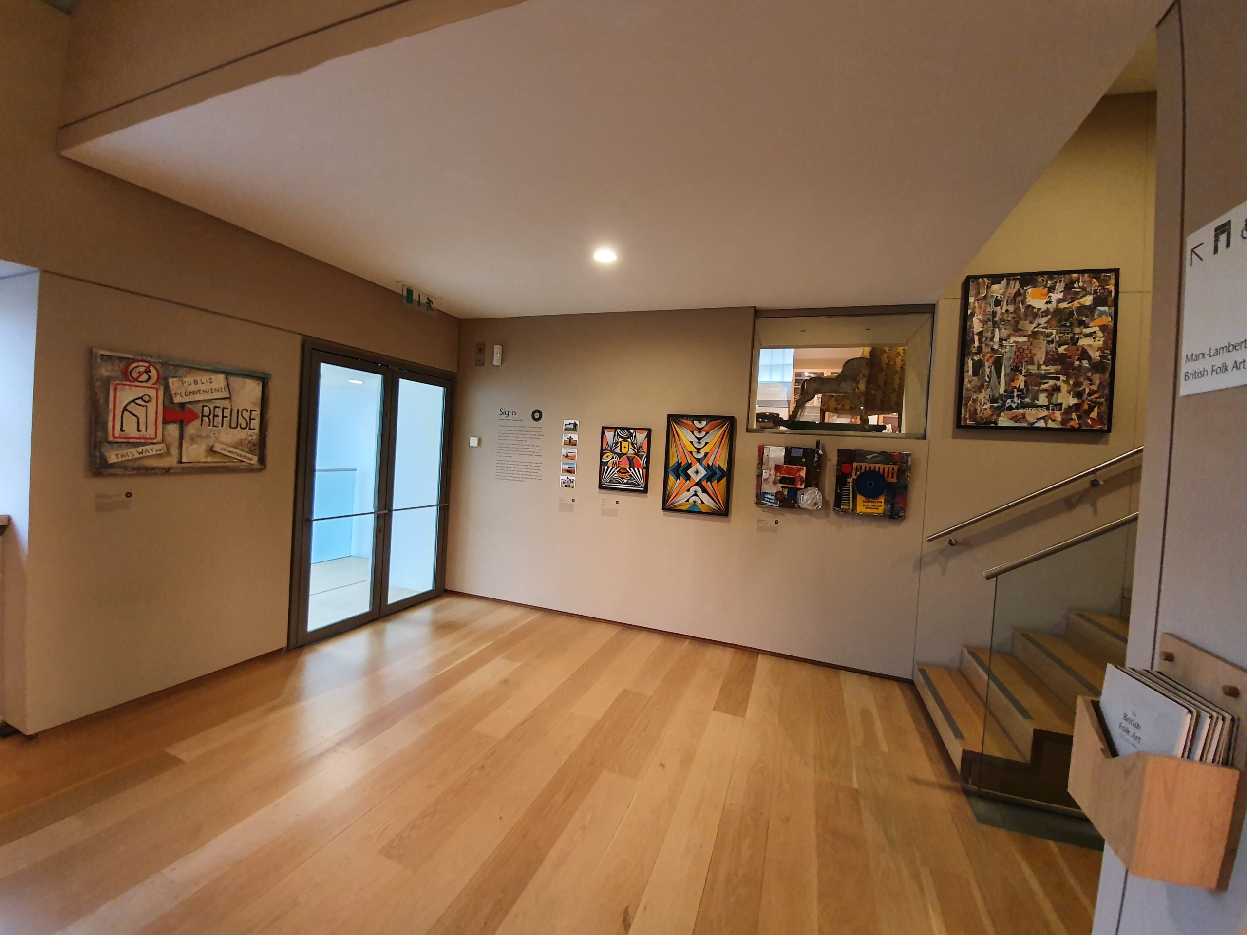 Gallery space with 5 artworks displayed on the walls