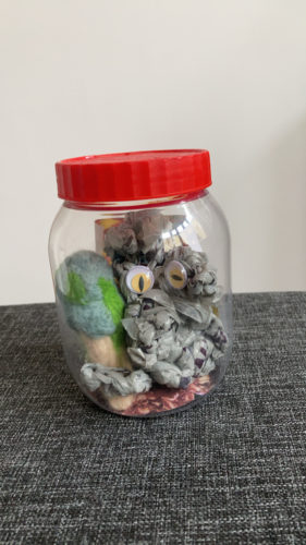 Plastic bag monster in a jam jar by Sally Hirst